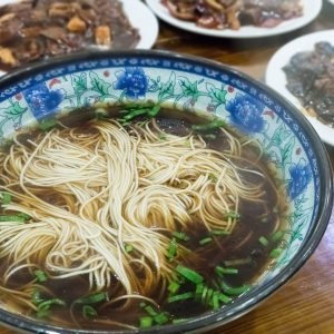 chinese noodles closeup, fresh soup and a variety of dishes in shanghai